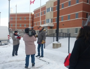 Albert speaking to the crowd and media outside the Brockville Mental Health Centre. Photo Credit: Julie Comber